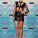 Miley is a punk — rocker, that is. The star showed off her fit frame in a leather bra top and bandage belt leather mini, both by Saint Laurent, at this year's Teen Choice Awards.