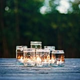 Go the simple route by arranging candles together in a mason jar.