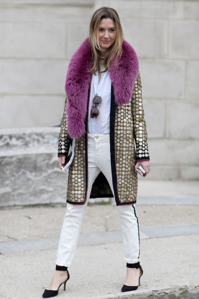Understated layers got a glamorous counterpart in this showgoer's fur-collared, metallic coat.