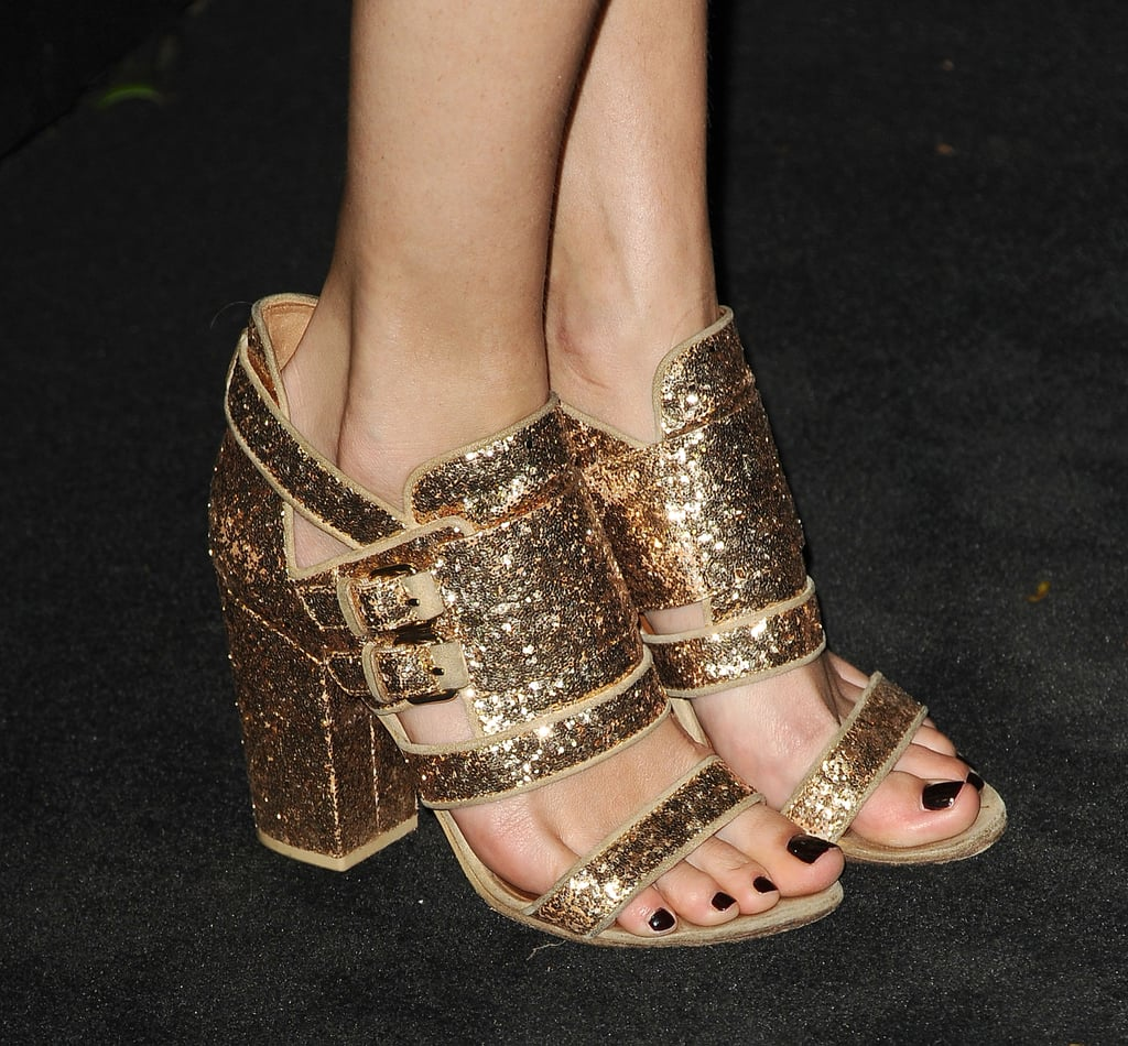 It was all about the glittery gold Givenchy sandals for Poppy Delevingne's Chanel look.