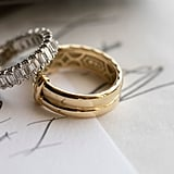 Dani wore an emerald cut eternity band by Tacori and Ian wore a custom designed yellow gold double band from the brand.