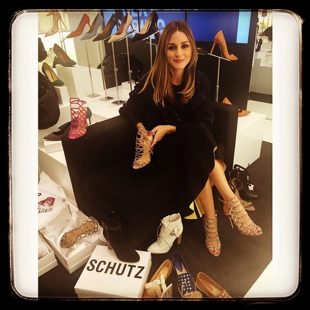 """Olivia snapped this pic from Schutz's new Madison Avenue store, with the caption """"A little shoe shopping and a color dilemma.... deciding on the Juliana sandal #cantdecide #loveallthecolors @schutzshoes."""""""