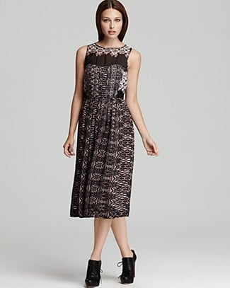 This vintage-feeling dress would be the perfect contrast against Fall's edgier lace-up booties. Of course, you can always play up the femininity with equally delicate footwear.   Tibi Sleeveless Pleated Cobweb Lace Dress ($550)