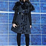 As a longtime fan of Karl Lagerfeld's work, Laetitia Casta came to support the designer in one of Chanel's beautifully embellished tweed coats.