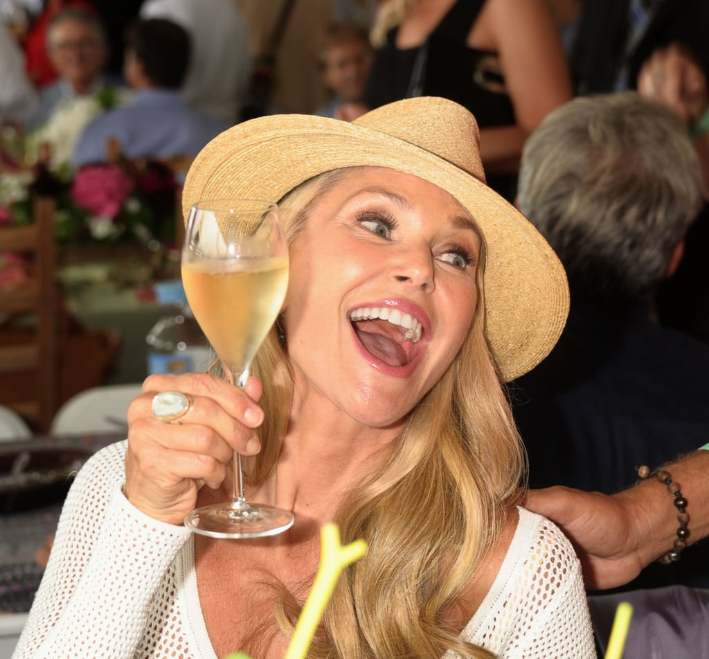 Christie Brinkley indulged in a glass of Champagne at the Hampton Classic on Labor Day weekend.