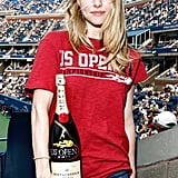Amanda Seyfried drinks champagne at the US Open.