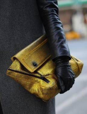 This gold number by 3.1 Phillip Lim is the perfect contrast against this gray coat.