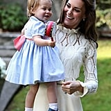 During the Cambridges' trip to Canada in 2016, Charlotte wore a sweet blue dress with a pink bow, perfect for a day of activities.