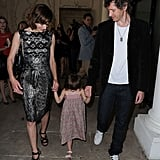 Milla Jovovich and Paul W.S. Anderson held Ever Anderson's hands as they headed to the show.