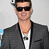 Singer Robin Thicke wore sunglasses on the red carpet.
