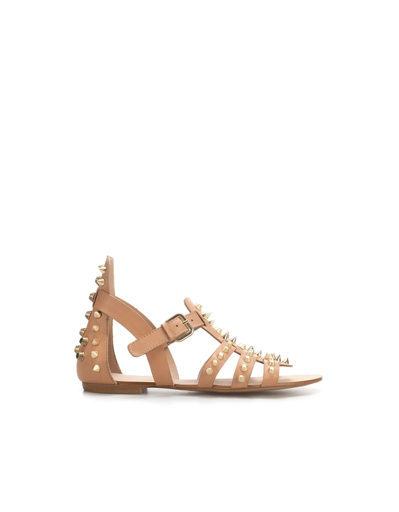 Gold studs toughen up these neutral gladiator-style sandals — a great, unexpected option for your everyday.