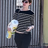 Anne Hathaway wore a pair of clear-rimmed shades.