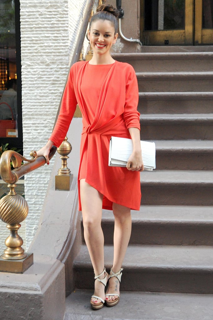 Nora Zehetner put a twist on the cocktail dress with a knotted red design while en route to Max Mara's launch party.
