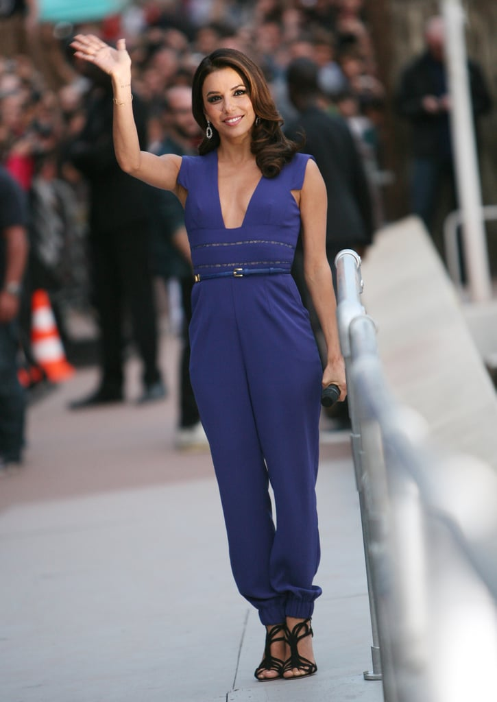 Eva Longoria wore a pretty blue jumpsuit by Elie Saab for her appearance on Le Grand Journal. To finish the look, she wore black strappy Rupert Sanderson sandals.