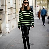One of our favorites: Olivia gave classic stripes a contemporary twist by selecting a neon green version and styling it with patent pants.