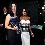Miss Congeniality 2 costars Regina King and Sandra Bullock were all smiles at the People's Choice Awards in January 2013.