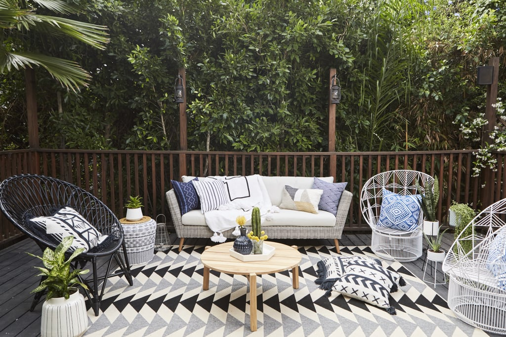 "Jamie's deck was stained dark, so when designing the space she says one of her first goals was to lighten the space up. ""I picked out the carpet and a couple of vases I thought would look really nice, and the Joss and Main team picked out these cool wicker chairs and sofa."""