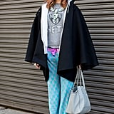 Pajama-style trousers topped with a well-worn tee have cool-girl, eclectic appeal.