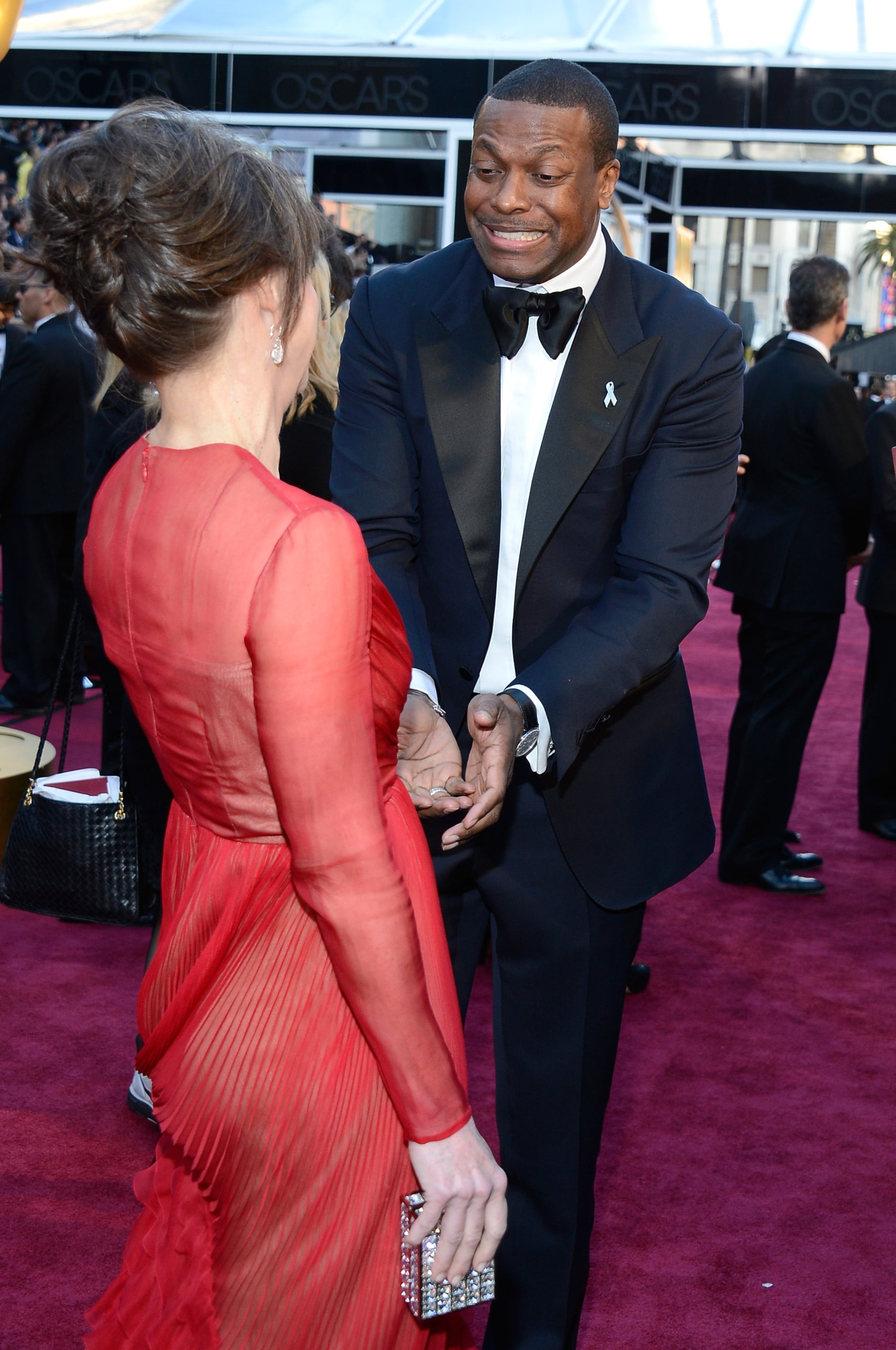 Sally Field and Chris Tucker stopped for a chat.