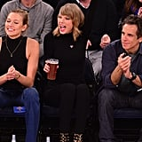 She can enjoy a cold beer while sitting courtside with her pals.