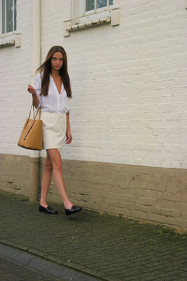 For a sophisticated take on Summer work attire, style a crisp white top with an ivory-hued skirt. Loafers included. Photo courtesy of Lookbook.nu