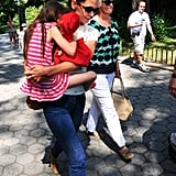 Suri Cruise held tight to her mom in Central Park.