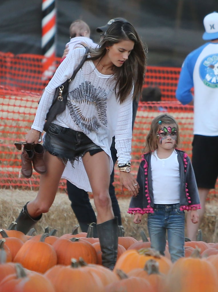 Alessandra Ambrosio scoured the pumpkins at Mr. Bones Pumpkin Patch with daughter Anja in LA.