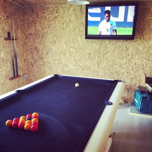 A man-cave shed gives space for billiards and sports.