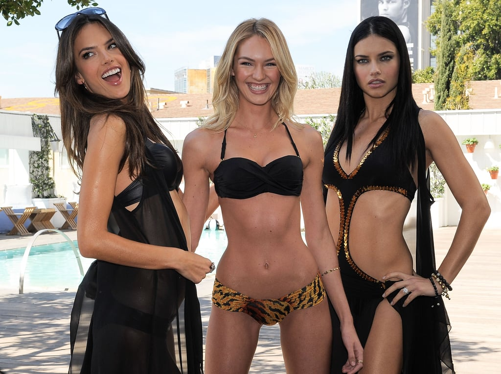 We gave you a glimpse of the Victoria's Secret gals working the Little Black Swimsuit last week, and now they're taking their bikini tour on the road! As if we needed convincing of how fab a simple (and slimming) a black cossie can be, Alessandra Ambrosio, Adriana Lima and Candice Swanepoel took to strutting around in the Victoria's Secret SWIM line in LA yesterday. As usual, it was hotness overload, with the sexy trio posing up a storm. Want some swim-spiration? Then flip through! Lunch time gym session, anyone?