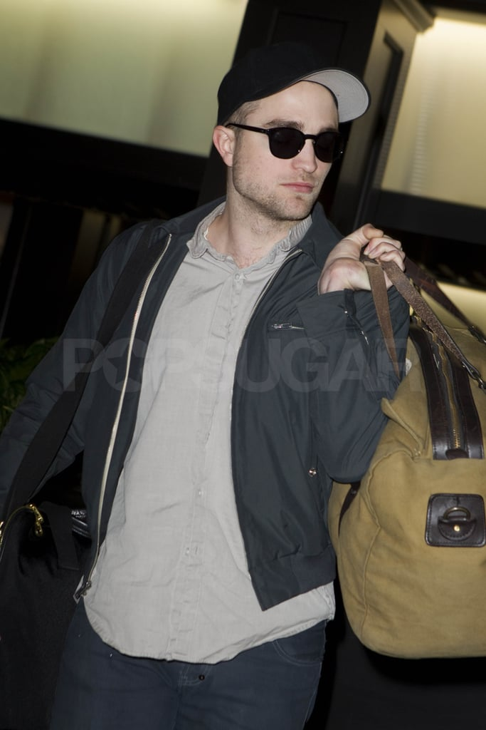 A fresh-faced Robert Pattinson departed out of LAX tonight carrying two bags. The actor is likely heading to Germany where his drama Bel Ami is schedule to premiere Friday night at the Berlin Film Festival. This year's competition has already played host to some of Hollywood's biggest stars like Angelina Jolie, Diane Kruger, and Meryl Streep. Rob shares the big screen with Christina Ricci, Uma Thurman, and Kristin Scott Thomas in the historical drama and we got a glimpse of the ladies vying for his love and attention in the Bel Ami's sexy trailer. The film opens in the UK on Feb. 22 followed by a US release on March 2.