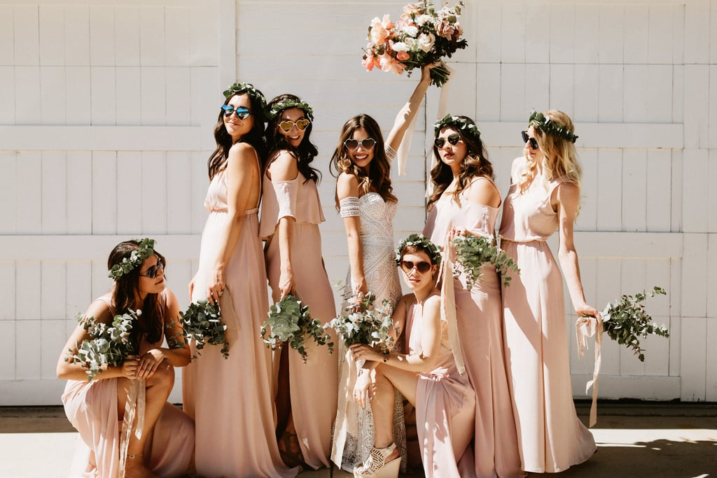 1faeb5aad1b6 This sunglasses-clad group of bridesmaids all sported floor-length blush  gowns.