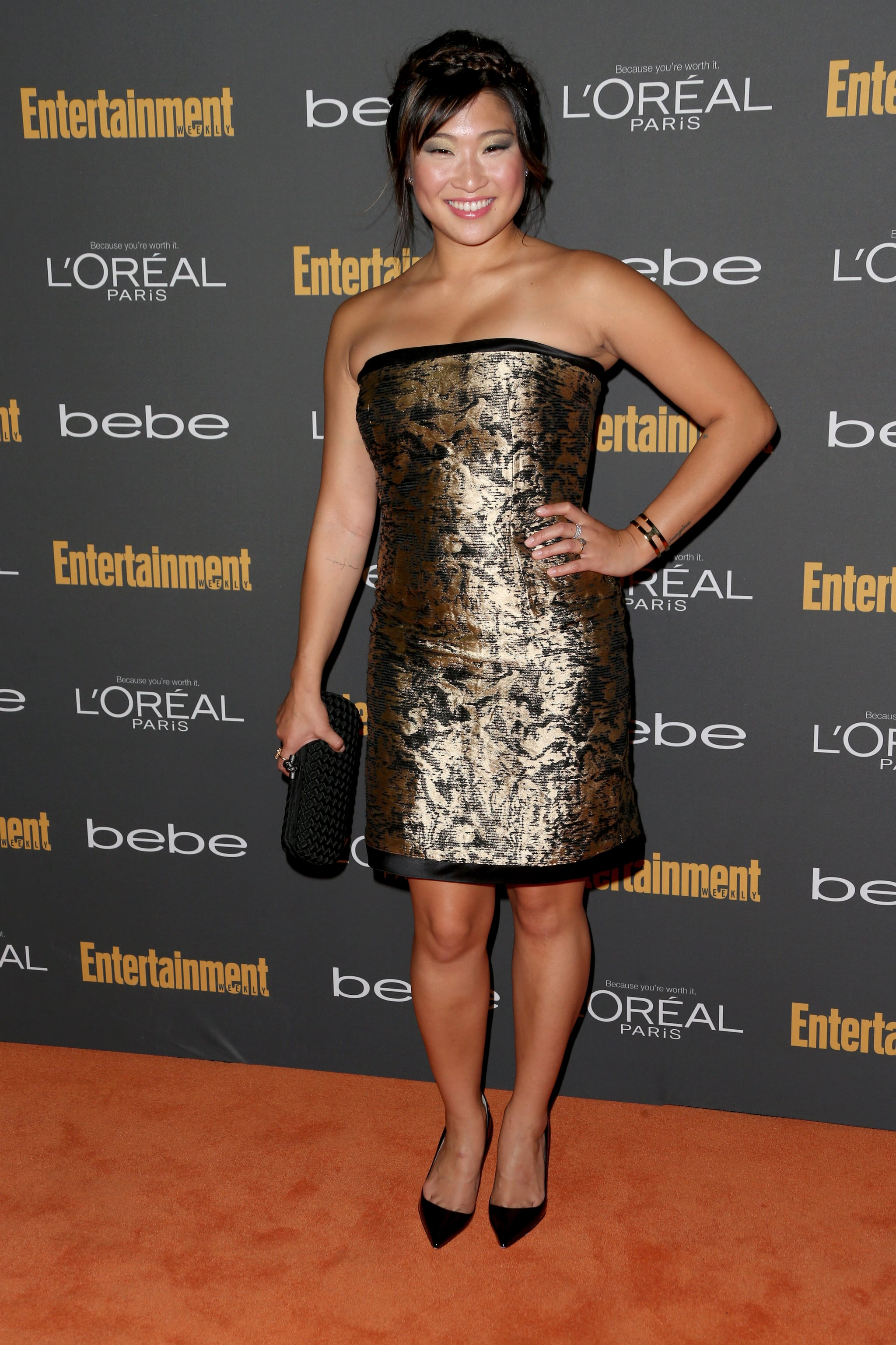 Jenna Ushkowitz shined in a gold metallic strapless minidress and black add-ons at the Entertainment Weekly pre-Emmys party.