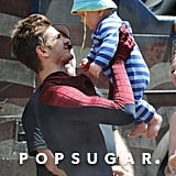 Andrew had fun with a baby between takes on the Amazing Spider-Man 2 set in NYC back in July 2013.