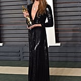 Alicia's Oscars afterparty look was another sequined Louis Vuitton creation, this one complete with a sexy plunging neckline.