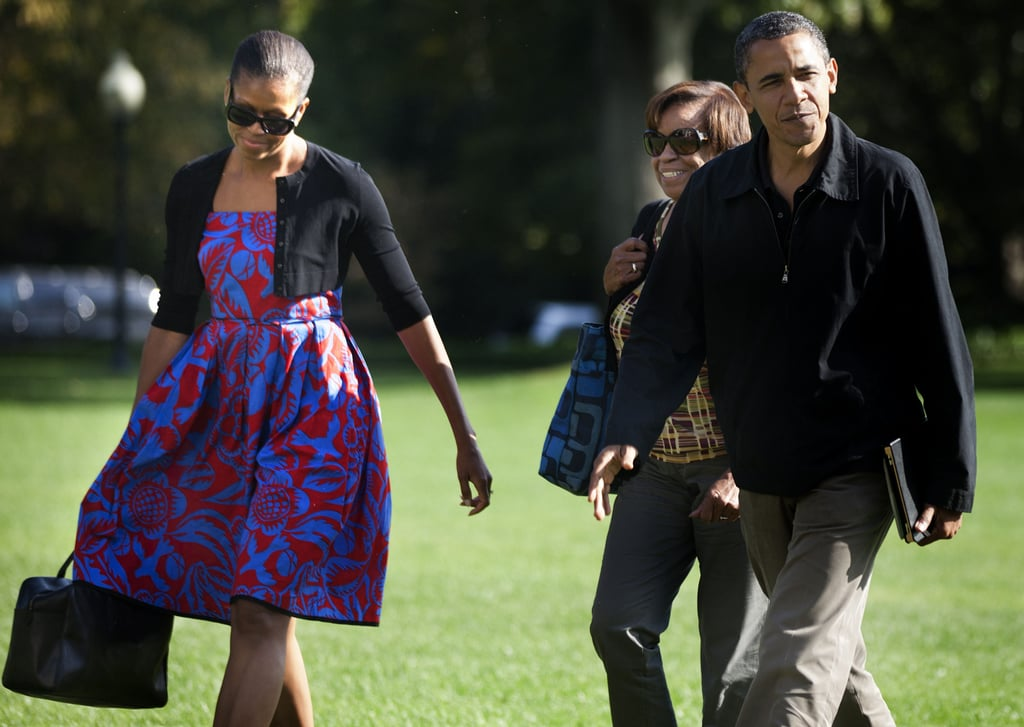 The first lady chose a bright floral Sophie Theallet dress and a black cardigan for a walk across the White House front lawn.