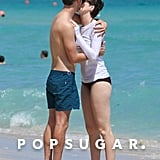 Anne Hathaway and her husband, Adam Shulman, shared an adorable moment on the beach in Miami in March 2014.
