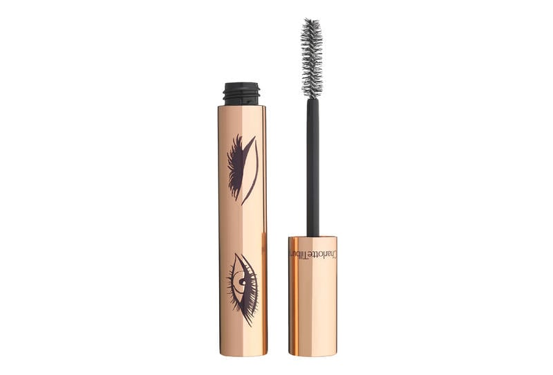 """We're already fully obsessed with Charlotte Tilbury's first mascara, Full Fat Lashes ($29) – and we aren't the only ones. In a recent conversation with Charlotte herself, she told is it's the number one bestselling mascara at Bergdorf Goodman.  Well, the British makeup guru is about to add a new product to our regular rotation with the launch of Legendary Lashes ($32), which was just released today.  Charlotte promises that the new mascara will give """"Hollywood-False Lash Effects"""" with the application of two coats. If any makeup artists can make such a claim, it's surely Charlotte; her long roster of A-List clients knows that she's the one to turn to for a perfect red carpet look. In fact, Charlotte's model and actress clients inspired Legendary Lashes. """"This mascara was almost born on the red carpet,"""" Charlotte told us. """"Basically, when I'm doing all of those celebrities — when you're on the red carpet — you always want a little bit of extra umph. Even if you're doing a natural makeup look on Alicia Vikander or a dramatic look on Penélope Cruz, the lashes are always still a thing. You always want that Hollywood flutter."""" The special power of Charlotte's Legendary Lashes comes down to the applicator, which she's dubbed the """"Multi-Bristle Flutter Brush."""" It's equipped with bristles of different lengths, which work to make sure that every single lash is coated in the product for maximum elongation and effect. When it came to perfecting the brush, Charlotte actually thought of herself.  """"I've got the stumpiest lashes in the world,"""" she said. """"Not only are they blond, but they are also so fed up with me because I'm always like, 'Come on, girls!' and they're like: 'Ugh.' They're really short, and this mascara instantly grows them.""""  Legendary Lashes promises full, nighttime-ready lashes — but you have to apply it properly.  """"You do two pumps — and that's it,"""" Charlotte advised, referring to how one must dip the bush into the well. """"You can literally do both eyelashes and """
