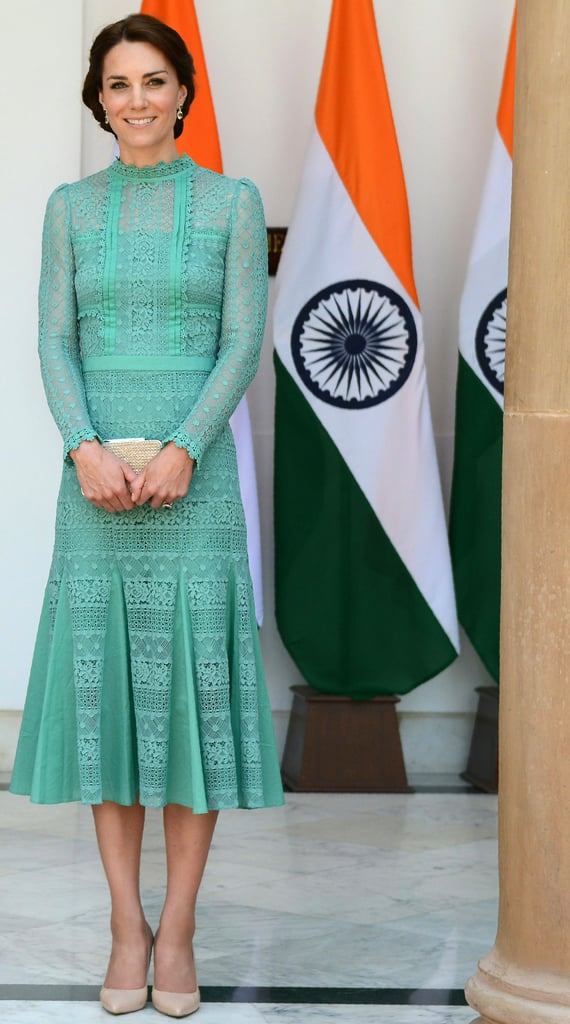 Kate Middleton's very fashionable royal tour of India continued Tuesday as she and her husband, Prince William, paid a visit to the country's prime minister, Narendra Modi. Over lunch and a photo op, Kate made another sartorial choice that paid homage to Britain; she wore a jade-green dress designed by Alice Temperley. The green dress was, of course, Kate's second outing in Temperley since arriving in India over the weekend. On Monday, Kate wore a two-piece Temperley set for a special gala held in honor of Queen Elizabeth's 90th birthday. Because the color of Kate's dress was so vibrant, she left the rest of her outfit slightly understated. Both her heels and clutch were a beige color, and she wore a two-toned pair of gemstone drop earrings. This was the latest stunning outfit from the duchess on her royal tour — make sure to check out all of Kate's fashion highlights from abroad!