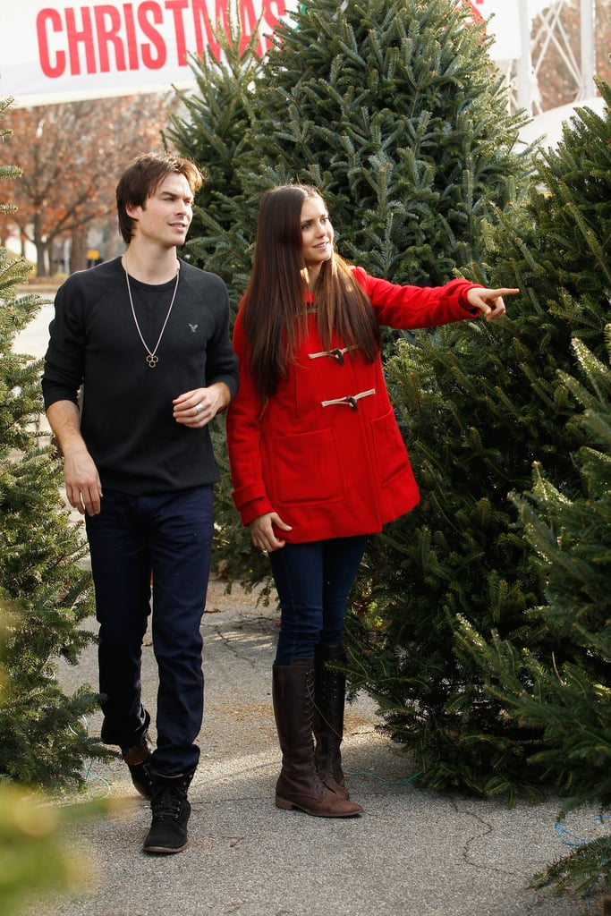 Nina Dobrev and Ian Somerhalder stopped by a Christmas tree lot in Atlanta on Monday. The couple browsed the selection and ended up taking home a large tree ahead of the holiday, which Nina plans to spend with family in the Rockies. Nina and Ian got in the spirit during a break from filming the fourth season of The Vampire Diaries. The show is up for multiple People's Choice Awards and both Nina and Ian are also in the running for individual honors. They could pick up the title of sexiest couple of the year as well if they beat out Robert Pattinson and Kristen Stewart in our Best of 2012 poll. There's still time to vote for that and the People's Choice Awards, which take place on Jan. 9 in LA.