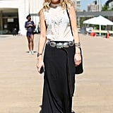 A draped black maxi got a boho-fresh finish with a Southwest-feeling belt and a lacy topper.