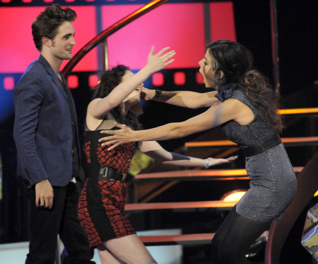 Sandra Bullock and Kristen Stewart shared a hilarious embrace during the May 2009 MTV Movie Awards in LA.