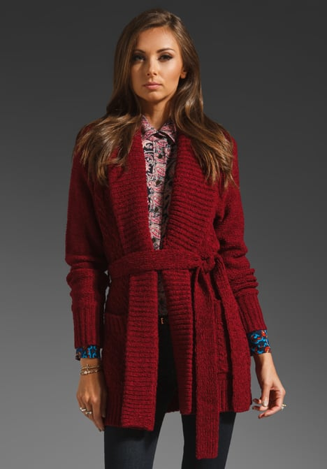 Tracy Reese's cranberry sweater coat ($173, originally $288) can easily pair with denim skinnies, or for a more downtown edge, wear it with leather leggings.