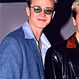 Justin grins behind shades at the Billboard Awards in 1998.