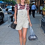Spring calls for short overalls and we love how Elsa Hosk wore a striped tee underneath hers.