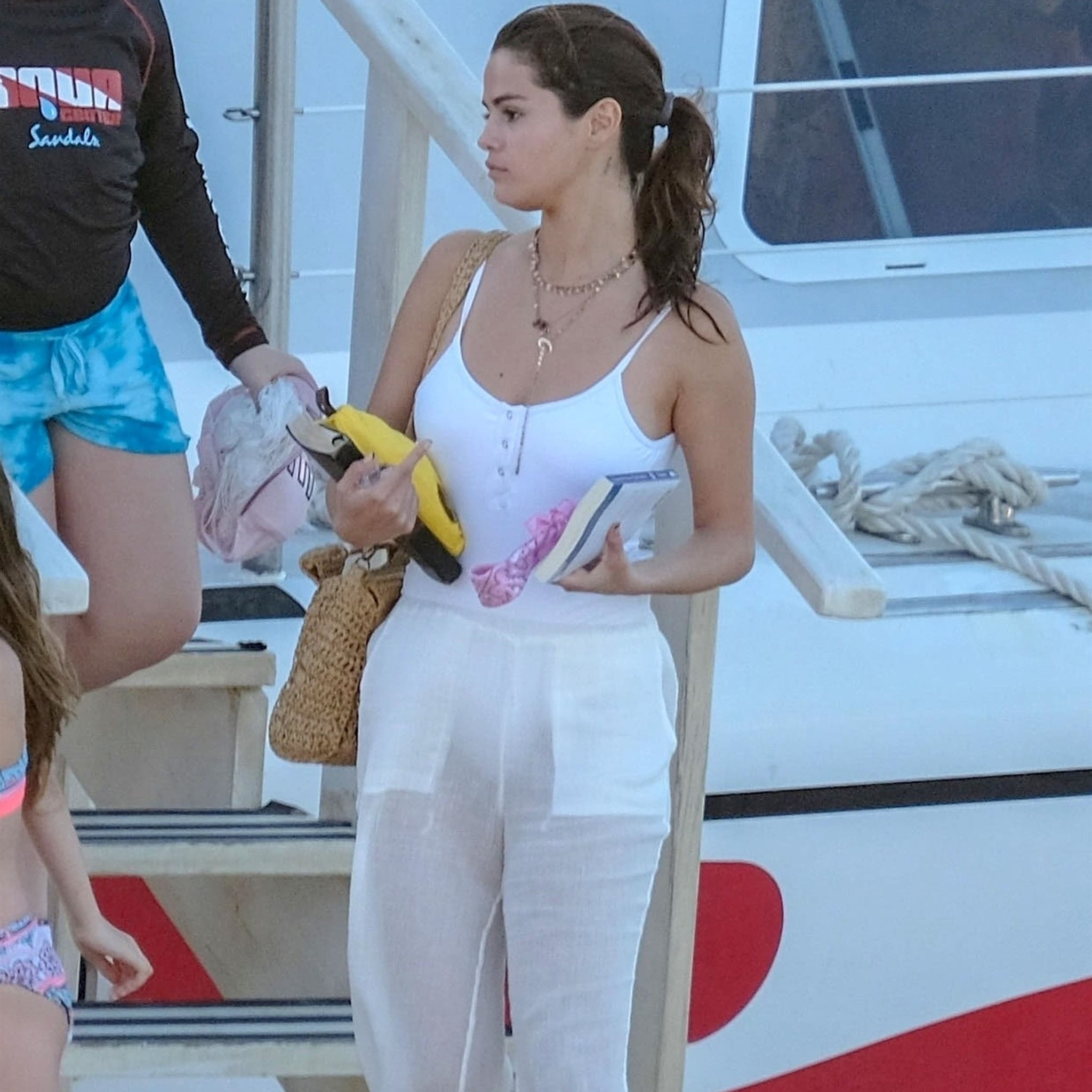 Selena Gomez\'s White Swimsuit With Buttons | POPSUGAR Fashion