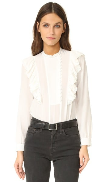The temperature in the office is never quite right. When the AC is on full blast, stay warm in a Rebecca Taylor long-sleeve ruffle top ($228) that can be worn with anything.