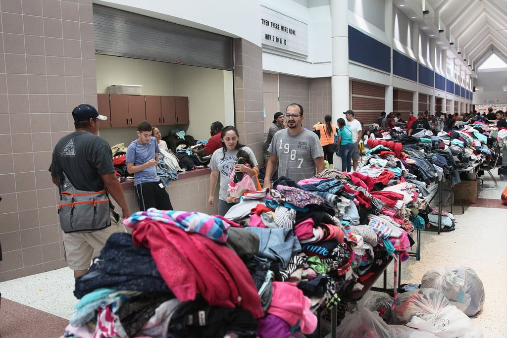 People Gather By Donated Clothes At A Shelter Hurricane Harvey