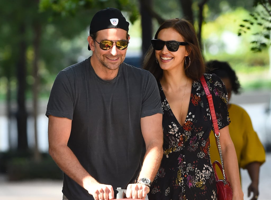 Bradley Cooper took a family stroll with Irina Shayk in NYC on Thursday. The A Star Is Born actor and his model girlfriend were all smiles as they made their way down the street in Soho with their 1-year-old daughter Lea. It's been a busy few months for Bradley, who has been zigzagging the globe while promoting A Star Is Born with his costar and new BFF Lady Gaga. The film is expected to break records during its opening weekend, and award season buzz surrounding the movie is at a fever pitch. Bradley and Irina have been dating since 2015 and welcomed Lea in April 2017. Irina has kept a low profile during Bradley's promotional tour, but we did see the two engageing in some hot and heavy PDA while vacationing in Italy over the Summer. Keep reading to see Bradley and Irina's sweet outing, then find out if he's really singing in A Star Is Born.      Related:                                                                                                           12 People Who Have Set Their Whole Weekend Aside For A Star Is Born