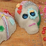 These basic sugar skulls have a grainy, sugary texture, which just adds to the skulls' authentic look. They can be decorated with a homemade egg-white icing, as well as whatever craft supplies you have on hand, such as sequins, jewels, glitter, and feathers.