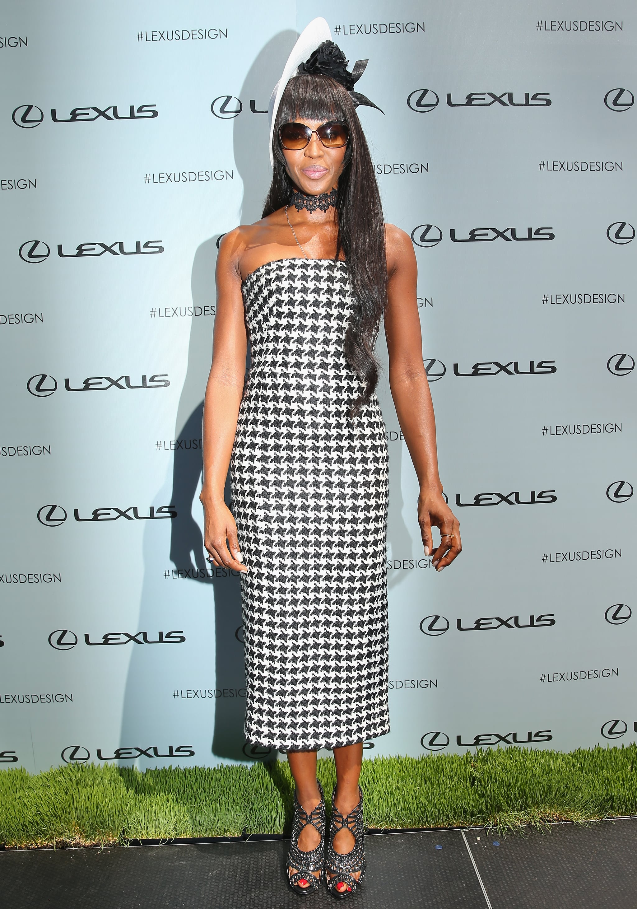 Naomi Campbell topped her houndstooth tube dress off with a coordinating fascinator at Victoria Derby Day.
